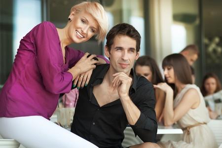 Handsome man next to cheerful women photo