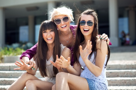 Portrait of three young ladies wearing sunglasses Stock Photo