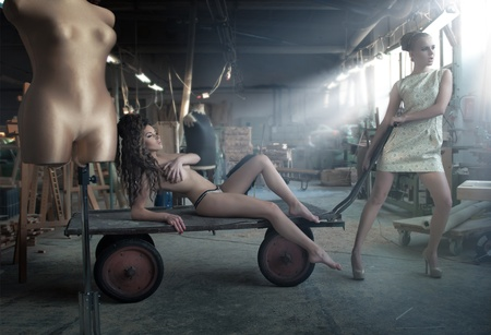 Two charming beauties in an old factory photo