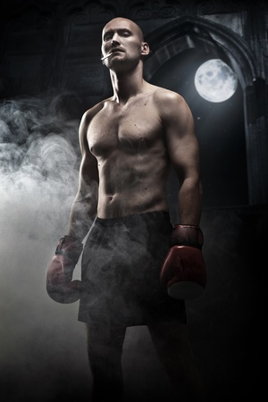 Mysterious photo of a handsome boxer Stock Photo