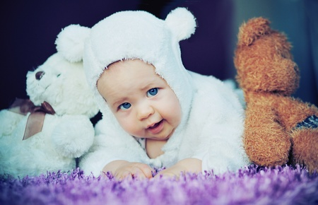 Cute baby with bears photo