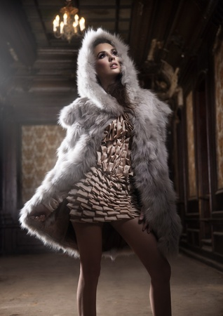 sexy fur: Young sexy woman wearing hood