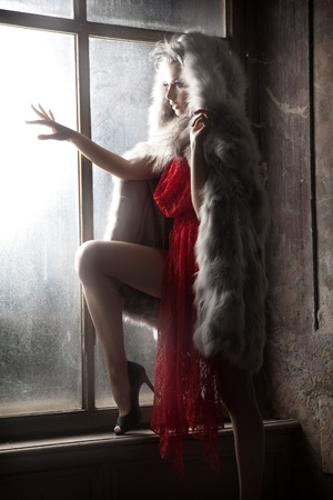 avantegarde: Sexy woman as a red hood looking out window