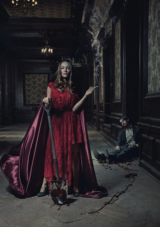 castle interior: Young woman and dead man Stock Photo