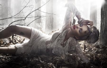 avantegarde: Beautiful lady lying and posing Stock Photo