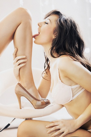 Photo of sexy woman licking leg Stock Photo - 12526344