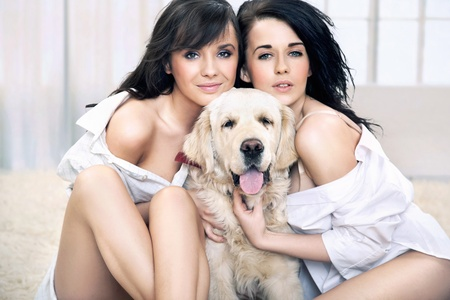 Cute women hugging dog photo