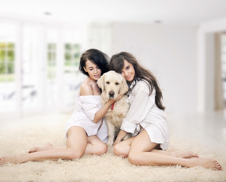 insides: Cute women with dog smiling Stock Photo