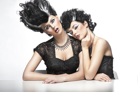 Two sexy women wearning wigs photo