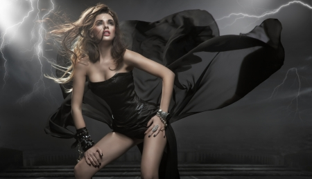 Gorgeous woman wearing black dress photo