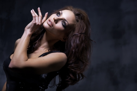 brunette: Dark photo of a sexy woman