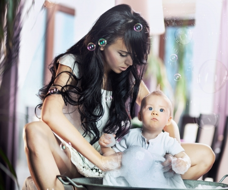 Young beauty mother and her child photo