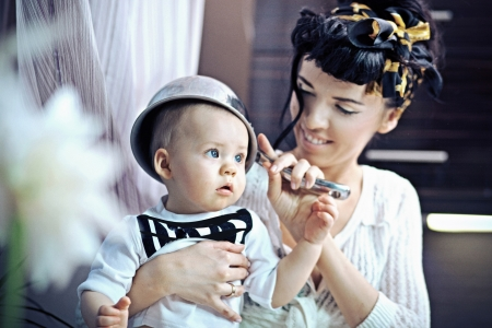 Beauty woman and baby with saucepan photo