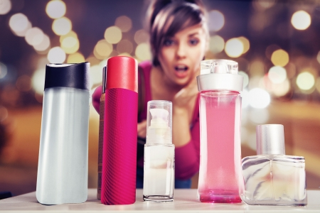 consumers: Surprised woman looking at perfumes