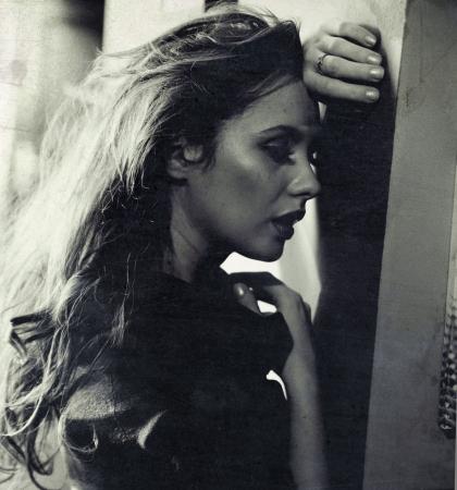 Nostalgic photo of a sad woman photo