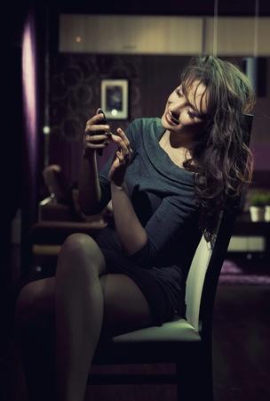 Elegant lady using smartphone photo