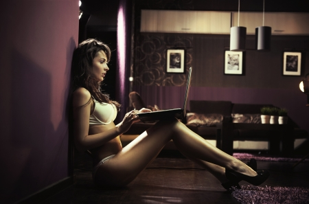 flirting women: Sexy lady browsing internet late night