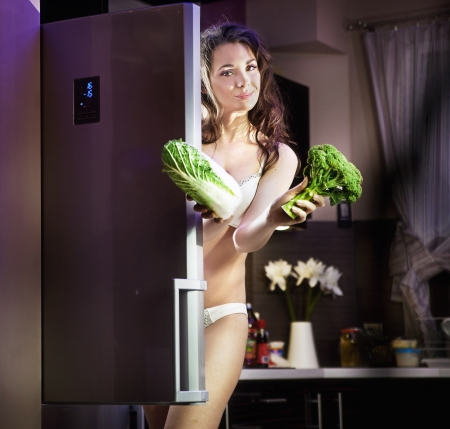 Young woman with vegetables  photo