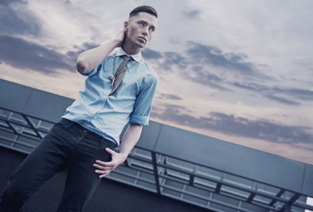 Handsome guy on a roof of a building Stock Photo - 13705429