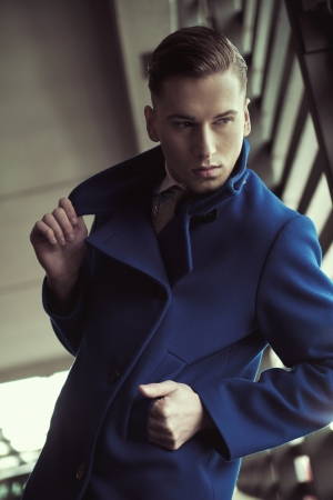 Young man in fashionable coat Stock Photo - 13705426
