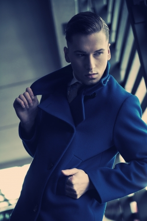 Young man in a fashionable coat Stock Photo - 13705419