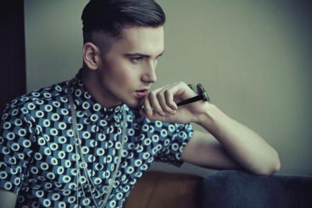 Vogue style portrait of a young guy photo