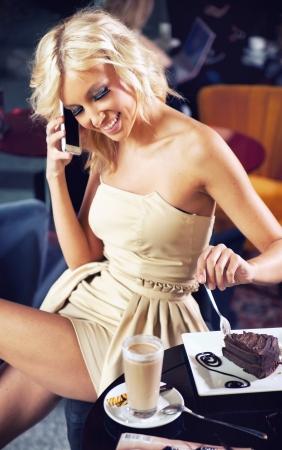 Beautiful girl talking by phone Stock Photo - 13705415