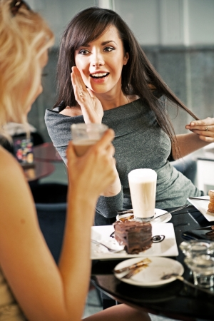 Two women chatting in a coffee shop Stock Photo - 13705408