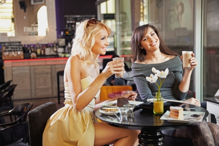 rumours: Two women at a cafe Stock Photo