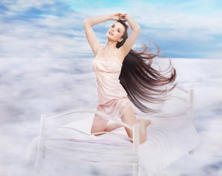 Long haired brunette in a dreamy scenery photo