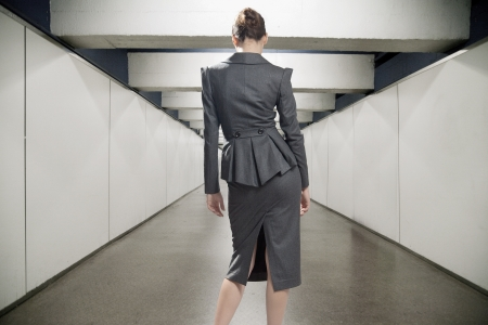 Conceptual image of a young businesswoman in a corridor Stock Photo - 14484762