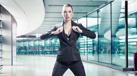 Conceptual image of a young businesswoman in a corridor Stock Photo - 14484764