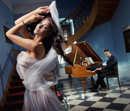 Sexy woman dancing to the piano music Stock Photo - 14484789