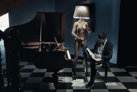 woman naked body: Naked woman as a lamp Stock Photo