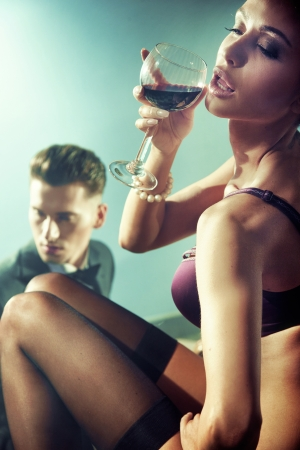 Sexy nude woman with glass of wine Stock Photo - 14484786