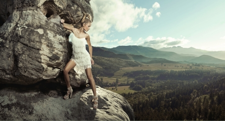 top model: Young lady posing in mountain