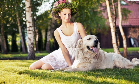 Smiling woman with dog photo