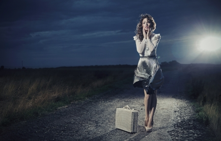 outdoor glamour: Retro woman with suitcase