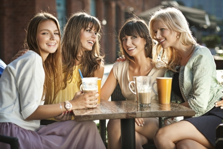 A group of women in the coffee shop photo