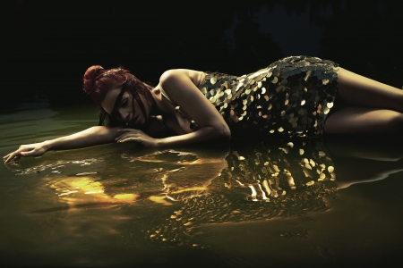 outdoor glamour: Attractive lady lying in liquid chocolate