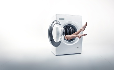 absorbed: Conceptual photo of a woman absorbed by household duties Stock Photo