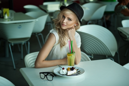 Young beauty in a restaurant photo