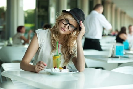 Cute woman in a cafe photo
