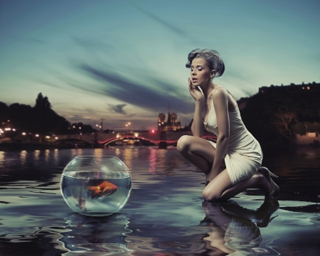 Beauty lady with gold fish photo