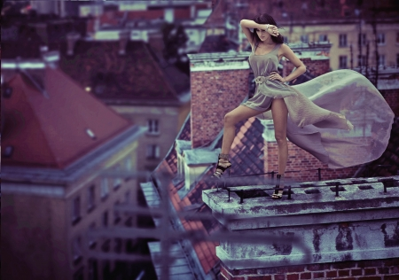 Fantastic photo of woman standing on the roof photo
