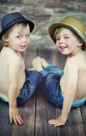Two little boys sitting photo