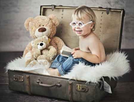 funny picture of little boy in suitcase photo