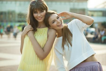 sidewalk talk: Cheerful young women