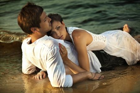 make love: Intimacy on the beach Stock Photo