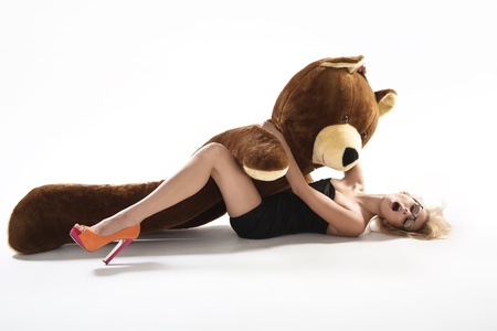Sexy blonde with huge teddybear Stock Photo - 16383263
